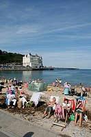 people on the beach in llandudno north wales uk