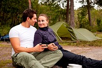 A happy couple outdoors on a camping trip