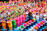 A background of traditionally made colorful clay toys of vintage soldiers, rural people and warriors for sale during Diwali festival in India.