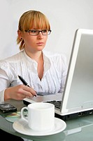 Young businesswoman, secretary or student with laptop
