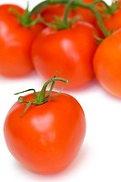Ripe red tomatoes on a white background with clipping path