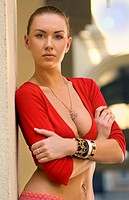 portrait of beautiful dancer in red shirt in downtown