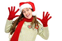 Beautiful young girl with santas hat isolated in white