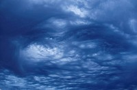 swirling blue storm clouds in sky