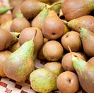 A pile of green pears at a market