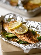 Trout with lemons and courgette in aluminium foil