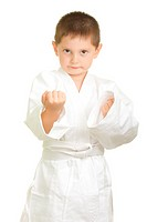 Little karate boy makes fists over white background