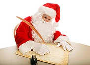 Santa sitting at his desk using a quill pen to make his naughty and nice list on parchment. White background.