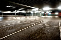 Night exposure of an empty parking level of a supermarket