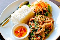Thai style food , spicy fried pork with rice and salad