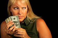 Attractive Woman Gets Greedy About Her Stack of Money