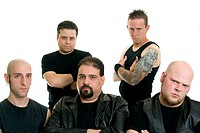Group of Caucasian men wearing black with serious expressions