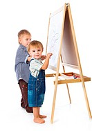 Boys are drawing on a blackboard. Isolated on a white background