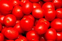 Red tasty ripe tomatoes put by background