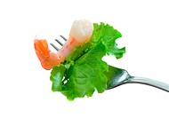 shrimp and leaf of lettuce on a fork