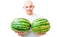 Young happy bold man with two watermelons fruit show double success,isolated on white