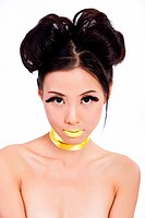 Young asian female with creative colorful makeup