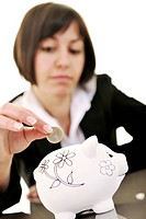 happy young business woman isolated on white puting euro money in piggy bank