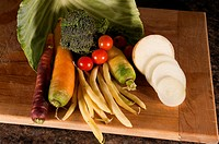Arrangement of many different vegetables on a cutting board