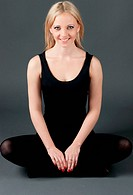 Beautiful smile blond young woman practicing yoga.