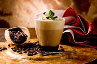 photo of delicious coffee beverage with whipped cream and coffee beans
