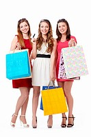 Beautiful girl with shopping bags and credit card on a white background