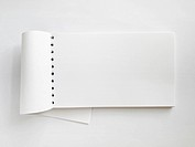 White Horizontal note book open on paper background