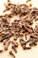 photo shot of cloves on kitchen table