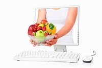 Female hand holding a bowl of fruits coming out from computer screen isoalted over white background