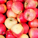 A pile of red apples at a market
