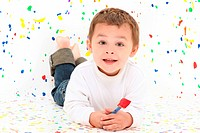 Adorable two year old toddler boy over paint splatter background in casual.