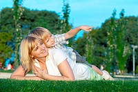 Mother and son playing on green grass