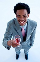 High angle of smiling Afro_American businessman holding a glass of wine