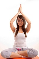 Attractive asian filipina woman doing yoga
