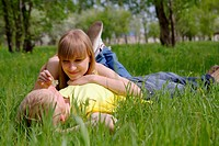 young beautiful woman and the man lay on a grass