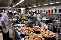 Kitchen of a school of hotel management, Lycee Economique et Hôtelier Joseph Storck, trainees, motion blur, freshly baked rolls in the foreground, Rue...