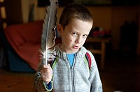 Boy with a vulture feather, Ludiente, Castellón, Spain