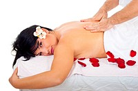 Attractive woman getting back massage by a real professional masseur