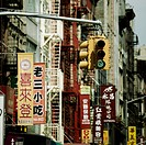 USA, New York, Traffic light and business flags in Chinatown