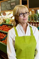Senior market employee looking away