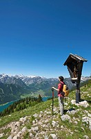 Hiker and Lake Achensee as seen from Durrakreuz viewpoint, Tyrol, Austria, Europe