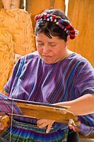 Guatemala, Woman Using A Loom To Weave Fabrics