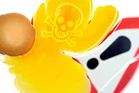 Cracked egg with a skull symbol, symbolic image for dioxin contamination in chicken eggs