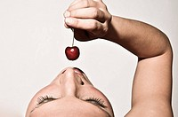 Woman Sensually Tasting A Cherry
