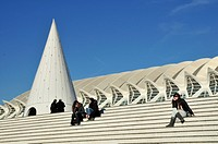 Tourists sitting on the steps of the Ciudad de las Artes y las Ciencias, City of Arts and Sciences, designed by Spanish architect Santiago Calatrava, ...