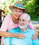 Outdoor portrait of beautiful senior couple in love.