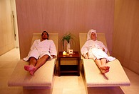 A couple relaxing at a spa together (thumbnail)