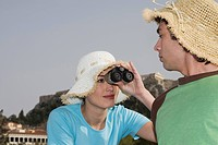 Couple at archaeological site with hats and binoculars