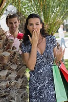 Woman with shopping bags, man with rose (thumbnail)