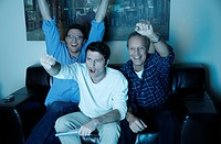 Three men watching a game on television (thumbnail)
